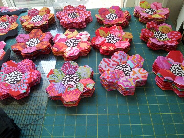 My freshly sewn hexagon flowers await their turn to be added to my quilt. Fabrics by Kaffe Fassett.