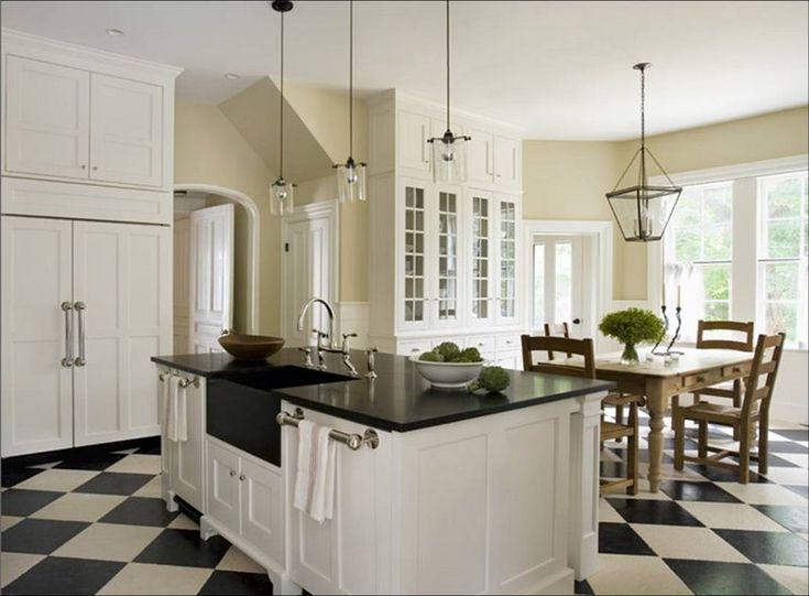 Google Image Result for http://smallburst.files.wordpress.com/2009/05/eric_roth_kitchen_white_traditional_cabinets_check_checkered_tile_floor_black_granite_countertops_lantern_pendant_light_chandelier_farmhouse_table.jpg