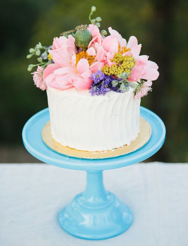 cute lil tiny cake  with local flowers and some to match bouquet on top?  i like this one  i love tiny things