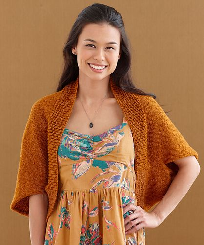 Add sparkle to a classic oversized shrug. This is a super-soft update of the Curtain Call Shrug. (Curtain Call has a center seam and this one does not.) (Lion Brand Yarn)