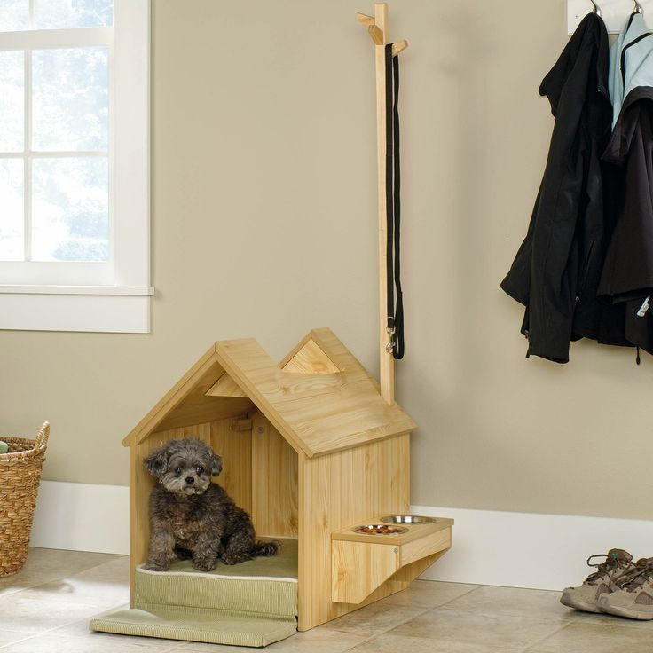This Sauder Pet Home Inside Dog House gives your dog a cozy place of their own. Perfect for small and medium-sized dogs, this indoor dog house provides a safe and comfortable oasis with a soft cushion inside. This pet furniture also contains bowls and supply space, making it a convenient option for both the pet and owner.