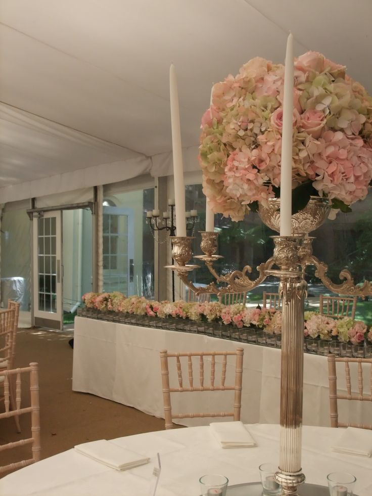 Stunning balls of pink roses and green hydrangea on silver candelabras make for an elegant setting at this marquee wedding. Flowers and styling by Victoria Whitelaw Beautiful Flowers.