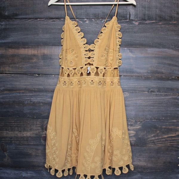 This embroidered mini dress has wavy cutouts and an open back for a flirty feel. Draped teardrops trim the hem. Adjustable, crisscross straps. Lined. Runs big!