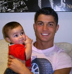 WHy does it have to be blurry. Cristiano Ronaldo and his adorable mini me Cristiano Jr.