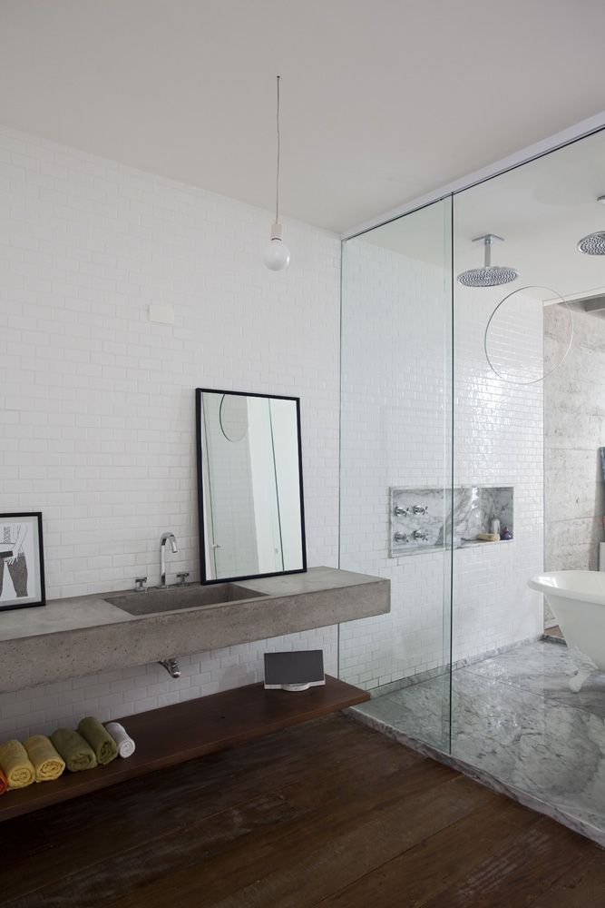 One-piece concrete slab vanity.  The wall behind the vanity could use a bit more decoration.  I like the open shelf space below the vanity and it's length.  I like how the shower / bathtub are all behind glass in a tiled room.