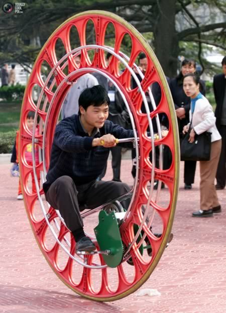 Chinese passers-by are surprised to see self-styled Chinese inventor Li Yongli's latest unicycle on a Beijing street.