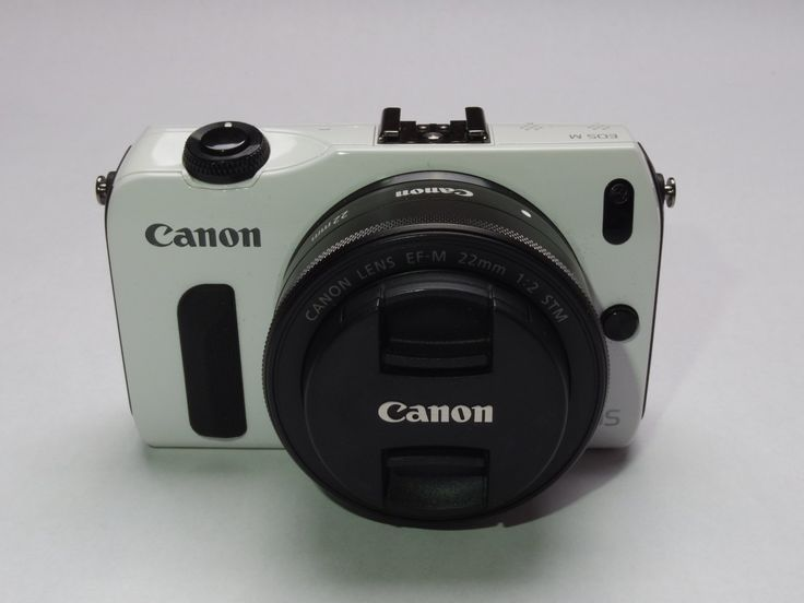 """Canon EOS-M Mirrorless Digital Camera with EF-M 18-55mm f/3.5-5.6 IS STM Lens (White). 18.0 MP CMOS (APS-C) Sensor. DIGIC 5 Image Processor. Full HD 1080p Movie with Focus Tracking. 3.0"""" Touch Screen LCD with 1040K-dots. Touch AF and Multi-touch Operation. Hybrid CMOS Auto-focus for Photo & Video. ISO 100-12800, Expandable to 25600 (H). Scene Intelligent Auto. Includes EF-M 18-55mm f/3.5-5.6 Lens."""