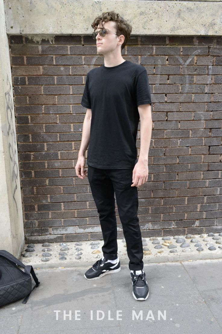 Men's street style | All Black Everything - You can never go wrong with an all black look. Grab a plain black tee and some matching plain jeans. Pair with some all black trainers and you're good to go. To reduce the dullness you can always add a silver or gold watch and maybe a cap like this one. | Shop men's clothing at The Idle Man