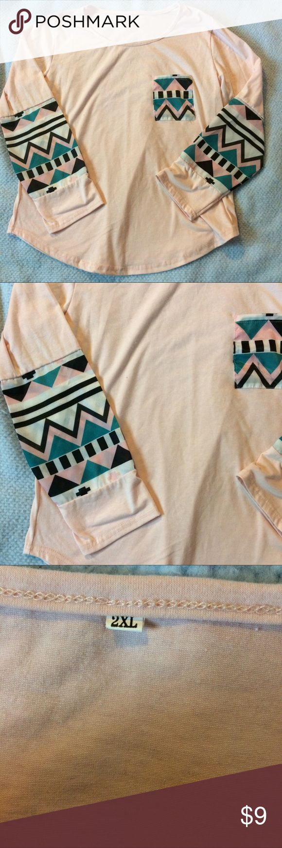 Long sleeve chevron pocket Tee Beautiful light pink color with Chevron print around the elbows and on the pocket. Size 2Xl but fits more like an extra large Tops Blouses