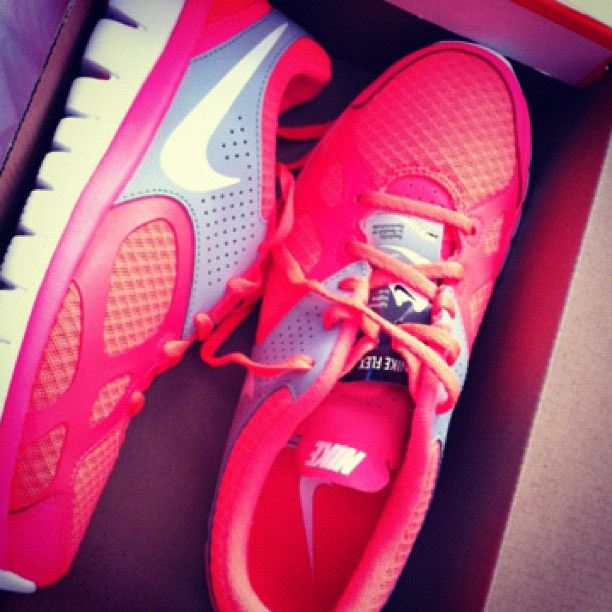 Pink Nikes, every girl needs a cute fun pair of running shoes