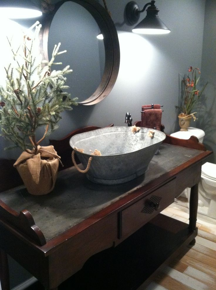my old couch table for the vanity and an old wash tub for the sink ...
