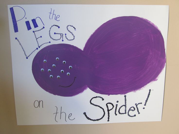 Pin the legs on the spider kid's Halloween game!