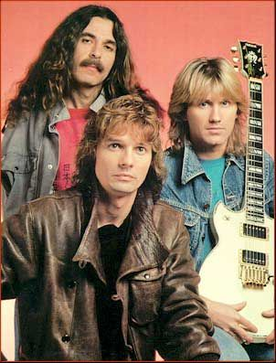 Triumph band from Canada. Rik Emmet  is the lead singer and a great guitarist and is so handsome!!
