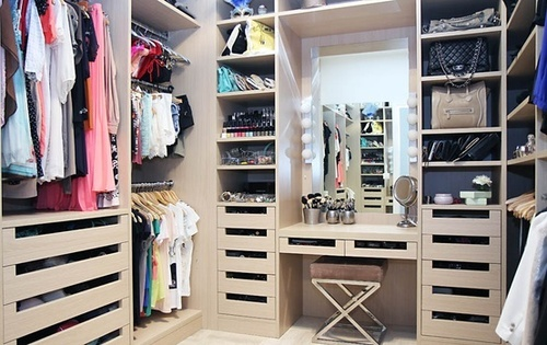 walk-in closet with make up counter