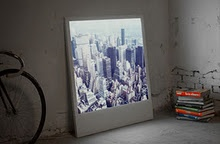 Polaboy, an LED-backlit photographic frame that is a direct 10:1 scaling up of a Polaroid snapshot