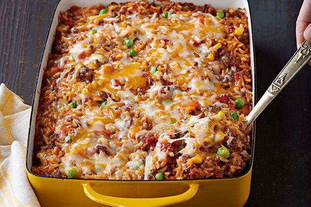 Here's a tasty way to make a pound of ground beef serve eight: a hearty beef and rice casserole made with Mexican-style cheese and taco seasoning.