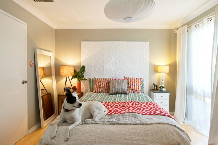 """Maya's bedroom - A quirky retreat with pressed tin headboard, linen bed cover from Moochie Lou. and statement light pendant. Walls painted with Dulux """"Still"""" in half-strength."""