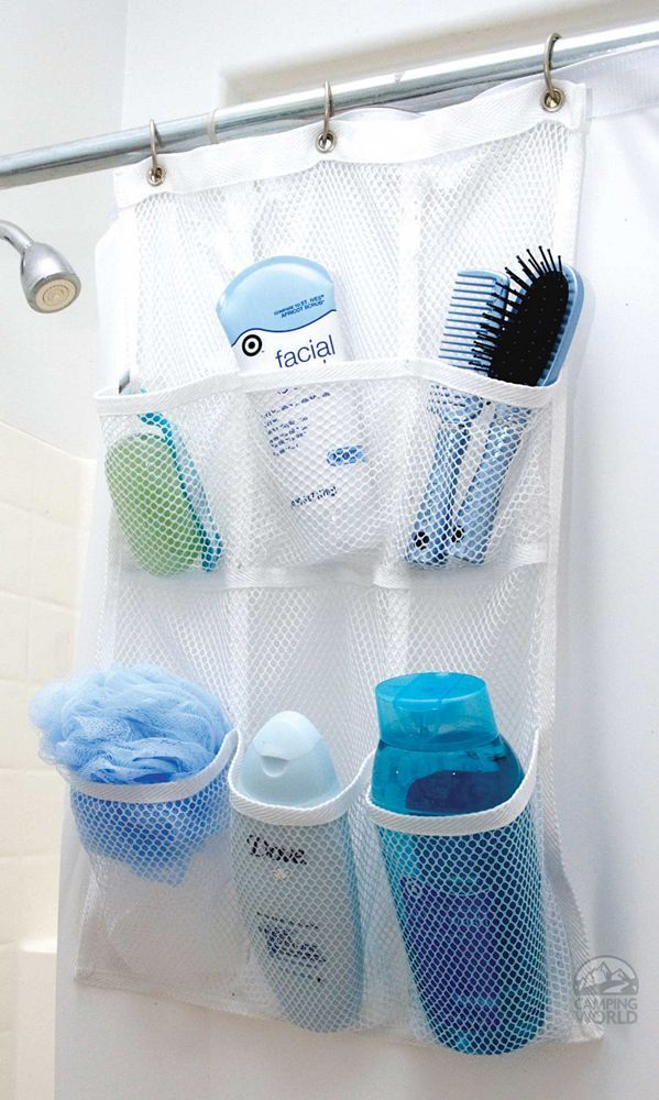 Hang a mesh pocket holder over the curtain rod on the inside for added storage for supplies. Just throw it in the laundry when needed.  Brilliant!