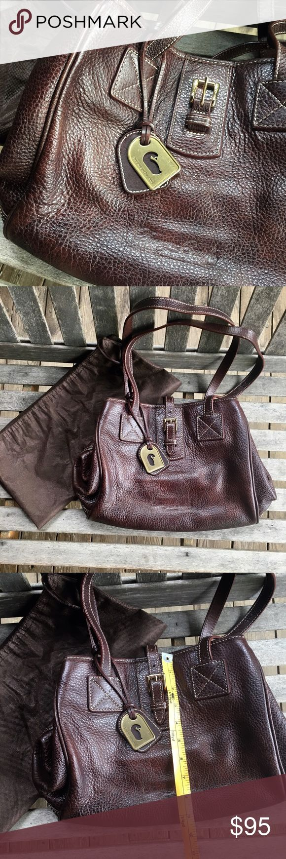 Dooney & Bourke cowhide medium tote Dooney & Bourke cowhide medium tote with dust bag. Buckle strap, textured brown leather with detailed contrast top stitching. Gently used for one season - some minor scuffing along seams (shown in last photo). Dooney & Bourke Bags Totes