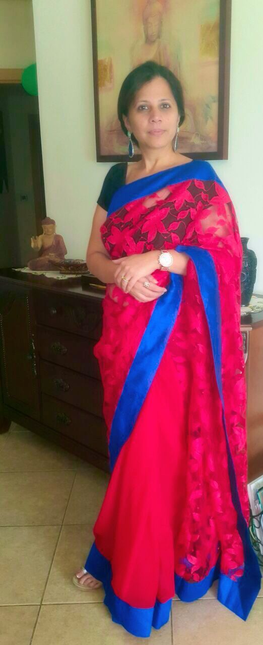 Red georgette & floral net Saree with royal blue border
