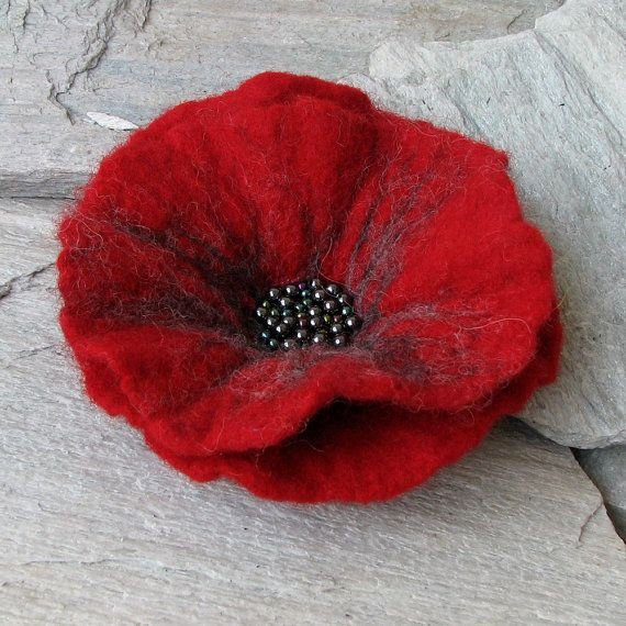 This felted flower brooch is a super accessory! It can adorn jacket, hat, dress, or handbag! It measures about 13 cm. Colour red, grey. It has a brooch