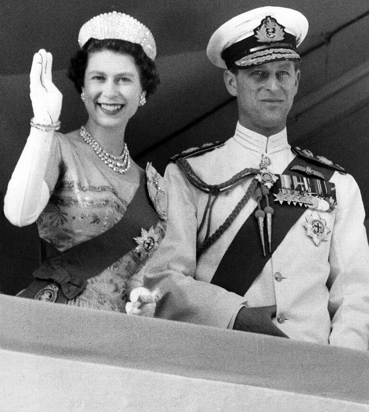 "February 1956: Tour of Africa. Queen Elizabeth II (Elizabeth Alexandra Mary) (1926-living2013) UK & husband Prince Phillip Duke of Edinburgh (Philip Mountbatten-born Prince Philip) (1921-living2013) Greece, waving at Kaduna, Nigeria during the Royal tour of Africa. Photo-Mirrorpix in newspaper ""Mirror""."