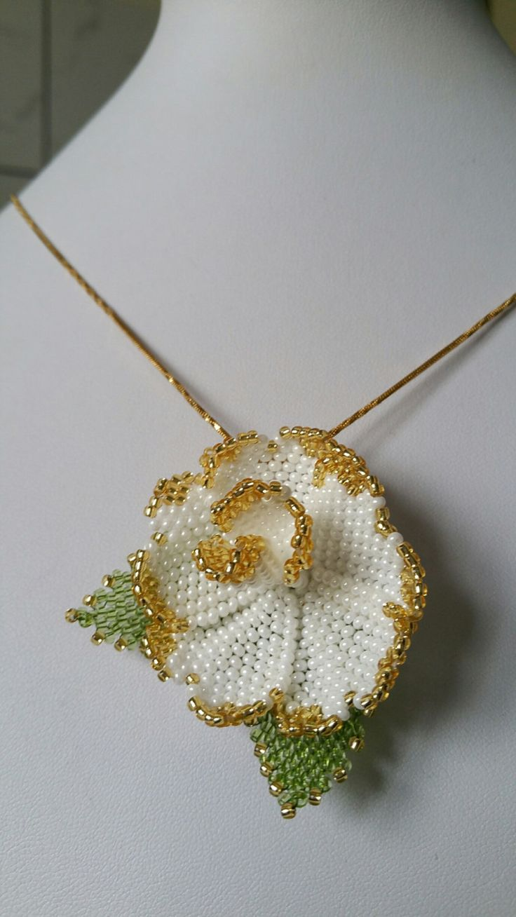 Embroidered white and gold rose on a necklace with toho beads.  A personal favourite from my Etsy shop https://www.etsy.com/listing/266635462/rose