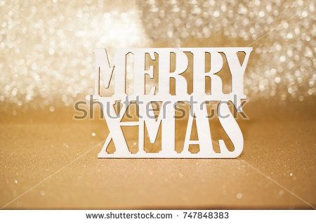 Merry Xmas text on golden blur light background