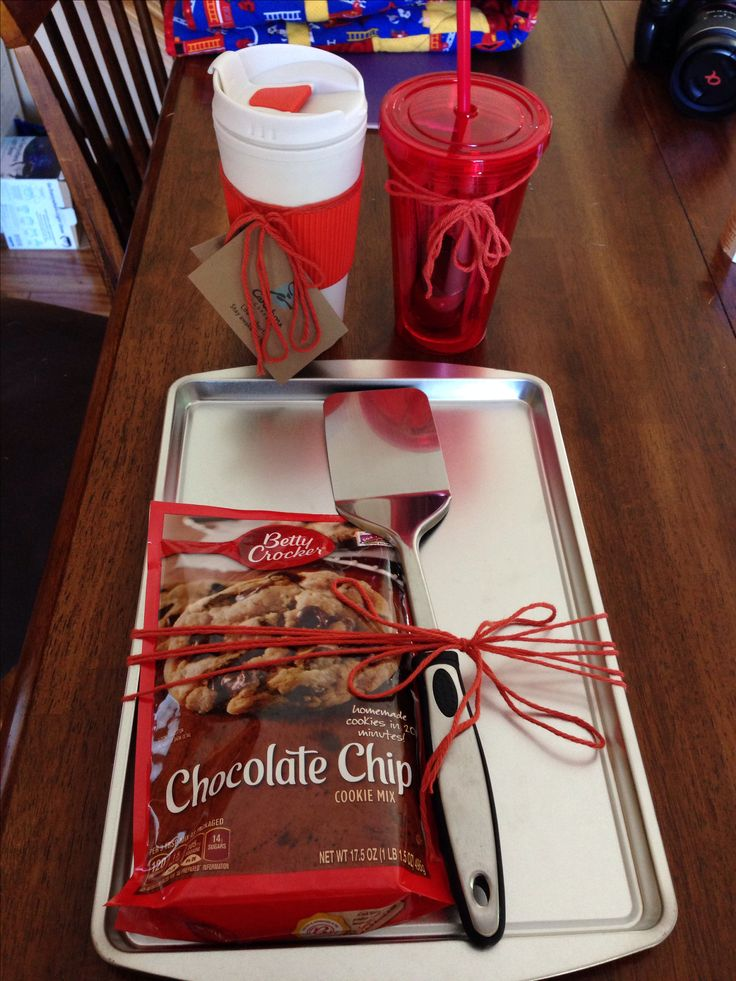 Fun bridal shower prizes. Tumbler with grift card, glass with crystal light and cookie sheet with spatula and cookie mix.