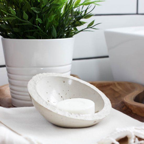 Make your own stylish concrete soap dish with just a few steps! The perfect modern accessory for your bathroom or kitchen!