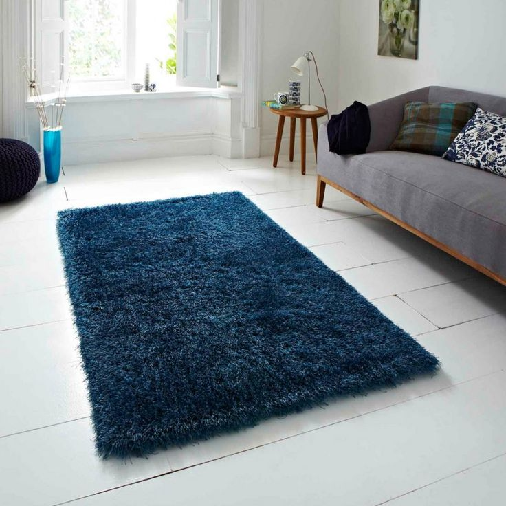Monte Carlo Blue Rug By Think Rugs This Monte Carlo Blue Rug By Think Rugs is a luxurious shaggy rug hand-tufted of a brilliant polyester and acrylic pile that gives this rug a satin or silk like feeling. This exclusive rug features a sleek, fashionable blue colour palette and the softest of hands that your feet will look forward to coming home to. #acrylicrugs #polyesterrugs #handmaderugs #blueshaggyrugs #plainrugs #shaggyrugs
