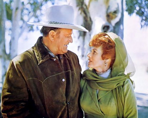 """John Wayne on Maureen O'Hara: """"She is a woman who speaks her mind and that impressed me, despite my old-fashion chauvinistic ways! She is feminine and beautiful, but there is something about her that makes her more like a man. It's her stubbornness and her willingness to stand up to anyone -- even John Ford."""""""