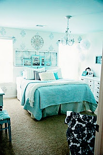 Awesome bedroom! Love the display above bed, the dresser with frames on the side and the stenciled wall