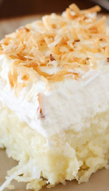 Coconut Cream Pie Bars Recipe ~ they are HEAVENLY... creamy coconut, a cloud of whipped cream, and a buttery shortbread crust