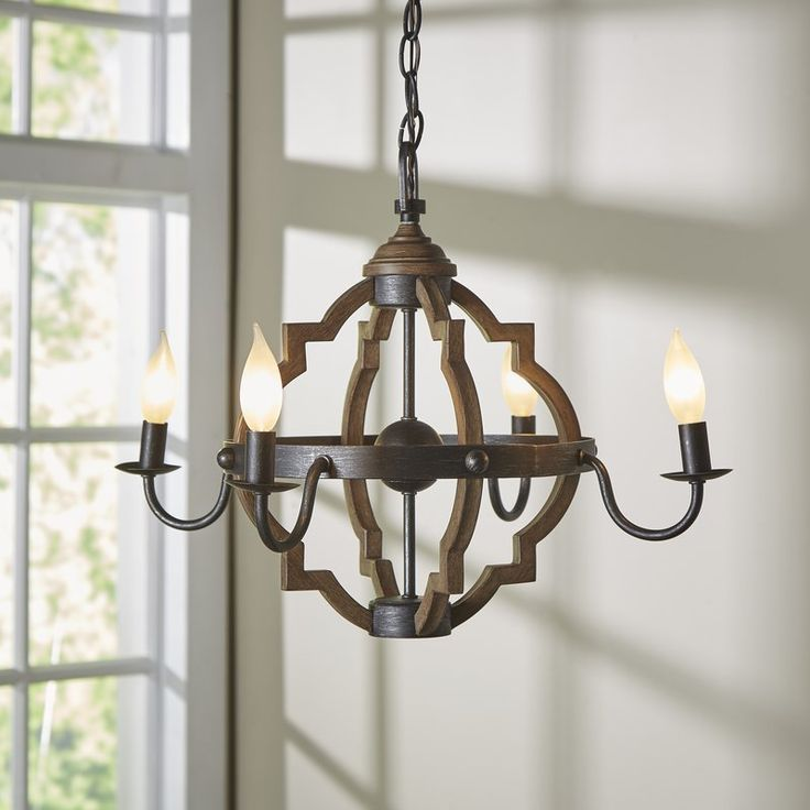 This 4-Light Candle Chandelier in stardust provides abundant light to your home, while adding style and interest. The transitional lighting collection features a classic, barbed quatrefoil profile …
