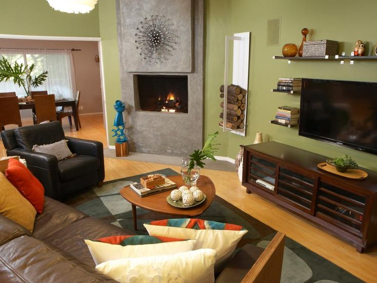 This living room gets a funky, fun feeling through pops of color in the pillows and artistic details over the corner fireplace.