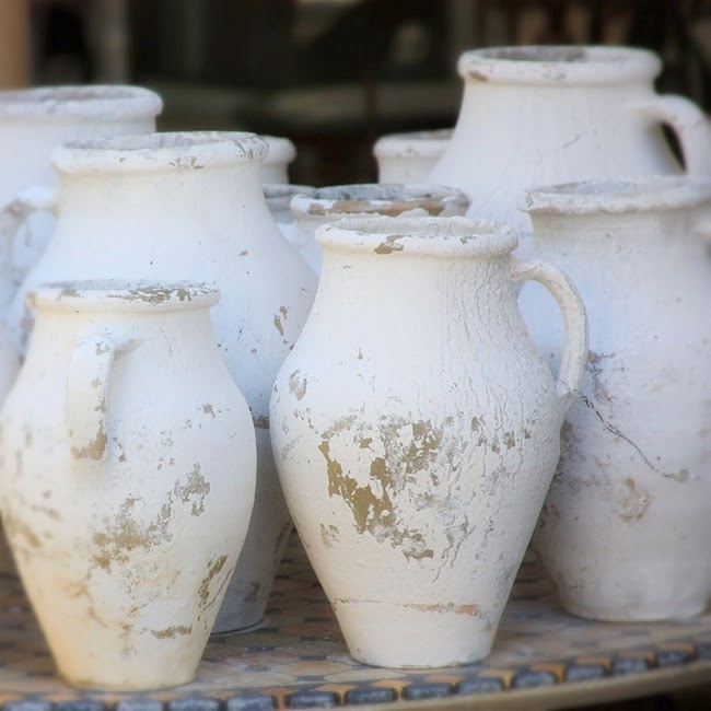 -a collection of white jugs