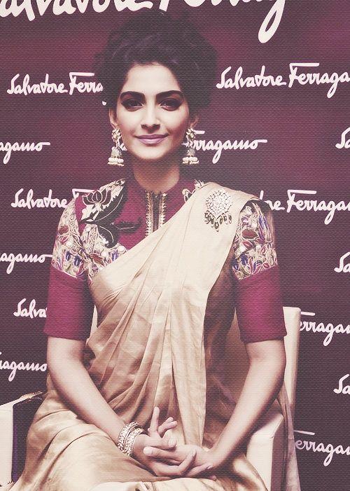 sonam_kapoor_wearing_high_neck_pink_blouse