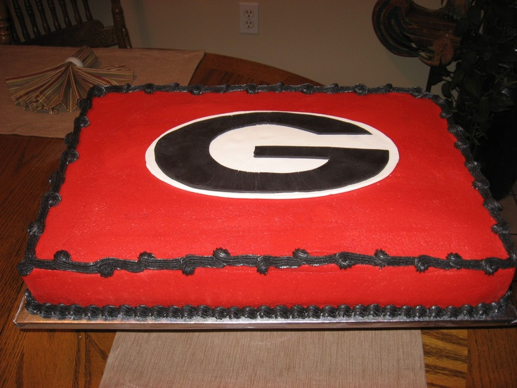 georgia bulldog groom's cake - This is a groom's cake with yellow cake and decorated with bc and fonant Georgia emblem.  Whole kitchen was red afterwards.  This cake was alot of fun.  Hope the groom will be happy.