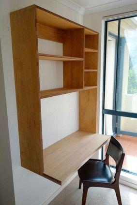 custom made floating plywood desk & shelves