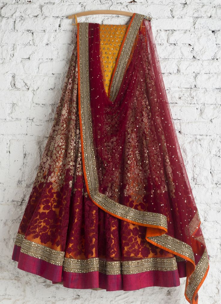 Lehengas by SwatiManish : Maroon lehenga with haldi blouse