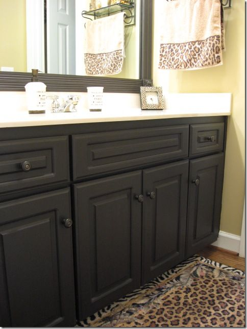 DIY laminate cabinet redo. These cabinets were white plastic laminate, and she primed them and painted them.