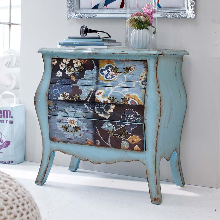 floral motif painted on bureau in blue tones