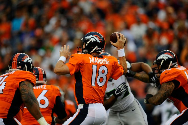 Description of . Peyton Manning (18) of the Denver Broncos passes against the Seattle Seahawks during first quarter action of a preseason game at Sports Authority Field at Mile High on Thursday, August 07, 2014 in Denver, Colorado.  (Photo by Kent Nishimura/The Denver Post)