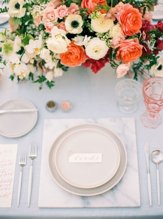 Colorful coral hued centerpiece: http://www.stylemepretty.com/2016/05/09/inspiration-every-boho-bride-needs-to-see/ | Photography: Danielle Poff - daniellepoff.com