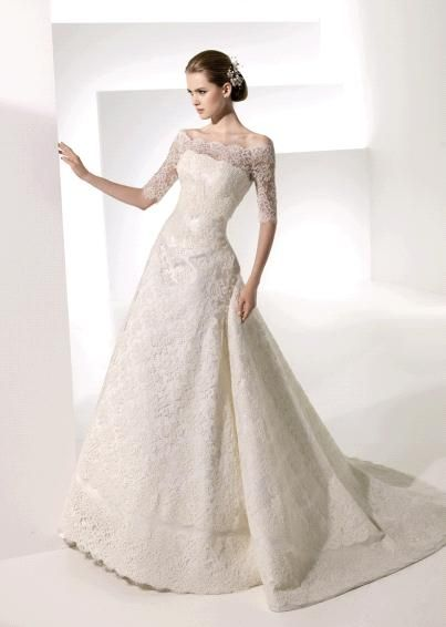 GORGEOUS!!! Manuel Mota's wedding dress style Tahiti is an ivory, off-the-shoulder neckline, a-line, floor-length gown.