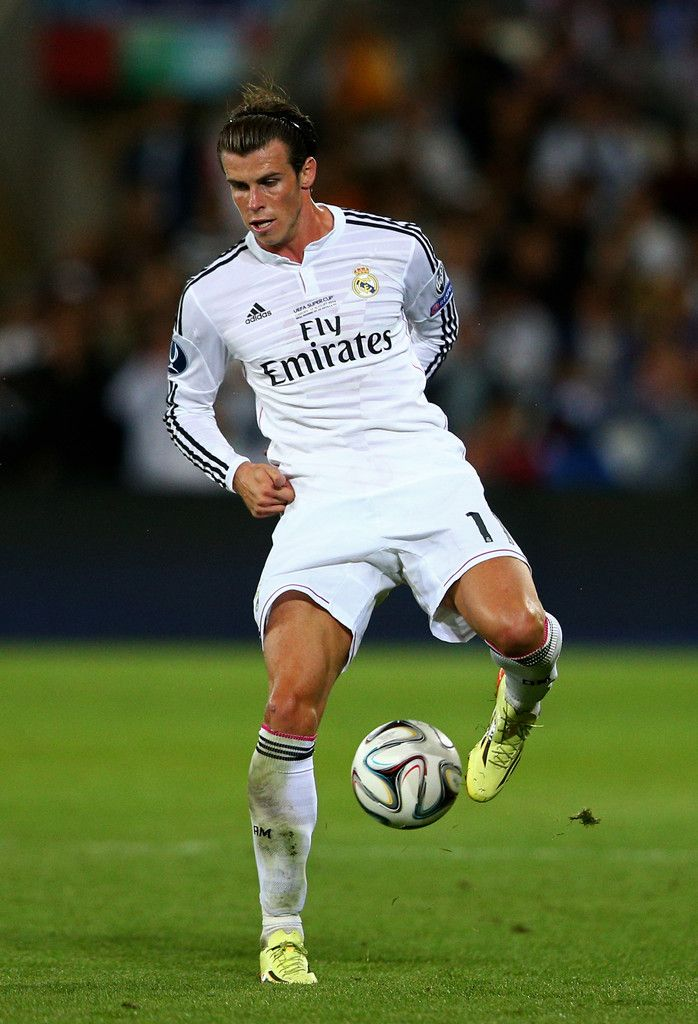 Gareth Bale of Real Madrid controls the ball during the UEFA Super Cup between Real Madrid and Sevilla FC at Cardiff City Stadium on August 12, 2014 in Cardiff, Wales.