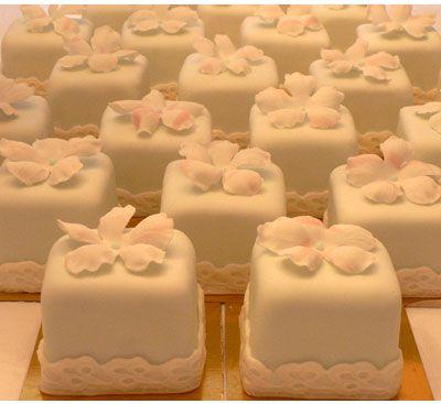 I love the mini cake idea and especially love the lace around the base!