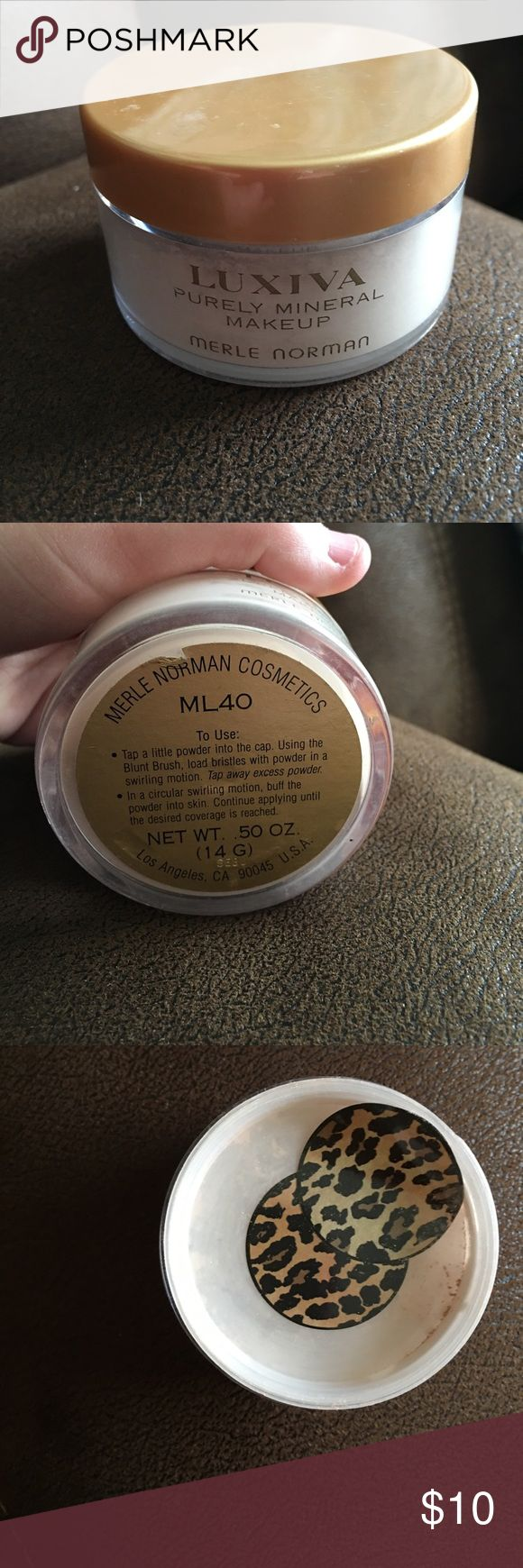Merle Norman powder Bought a few years ago and my skin was to sensitive to use it. It's only been used twice and over half full. Shade ML 40 which is a medium light. I put stickers over the holes so all the powder doesn't come out. Merle Norman Makeup Face Powder