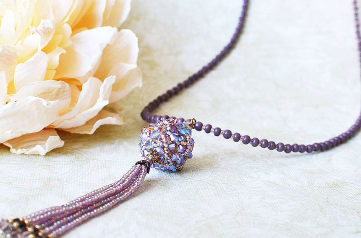 A Swarovski crystal beaded bead necklace with tassels. Custom order your choice of color for your bridesmaids!!